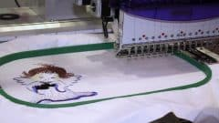 A beautiful picture embroider with a long-arm quilting machine